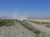 A potato trucks kicks up dust on a dirt road on the Tule Lake National Wildlife Refuge near the Oregon-California border.