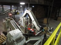 Chipping potatoes are piled into a large tote before being loaded into a truck at Gold Dust's potato packing shed.