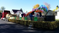 Gold Dust and Walker Brothers employees putting together a float for the 77th Annual Klamath Basin Potato Festival parade in Merrill, Oregon.