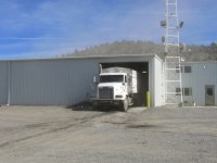 A spud truck backs into Gold Dust's packing shed to unload its chipping potatoes for shipping.