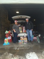 Tricia Hill and Bill Walker stand with over 60 toys donated by Gold Dust and its employees to the Klamath Falls Toys For Tots program.