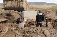 Ramon Sanchez and Robert Wedel install a new irrigation pump at an alfalfa field near Malin, OR.