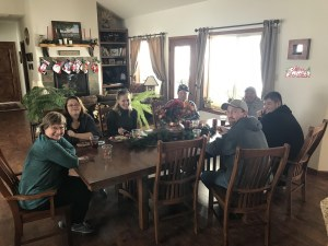 Marion Harp, Melissa Olsen, Suzanne Wallace, Matt Thompson, Salvador Vera, Erick Vera and Jesse Turner enjoying lunch at Jan Walker's house for Gold Dust's 2017 Office Christmas Party.