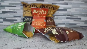 Bags of Kettle Brand potato chips on a kitchen counter.