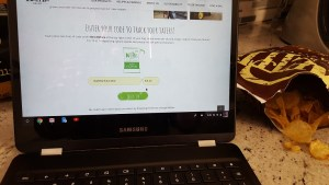 A photo of a Samsung Chromebook and Kettle Brand's Tater Tracker page opened with a chipping potato grower code entered in it.