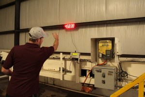 Gold Dust Potato Processors Plant Manager Matt Thompson demonstrating the big digital readout at the Malin potato processing plant.