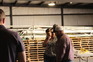 Tricia Hill and Kyle Patterson with an unknown guest at Gold Dust's processing plant during the 2018 Open House Field Day.