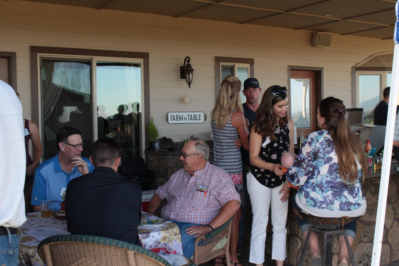 Old friends and guests visiting on patio at Bill and Jan's house for the dinner before Gold Dust & Walker Farms' 19th annual Open House Field Day.