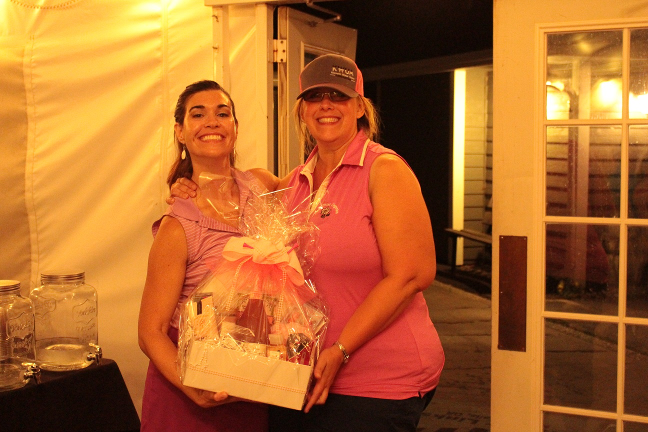 Lexi Crawford presenting Tricia Hill with a prize for Women's Longest Drive.