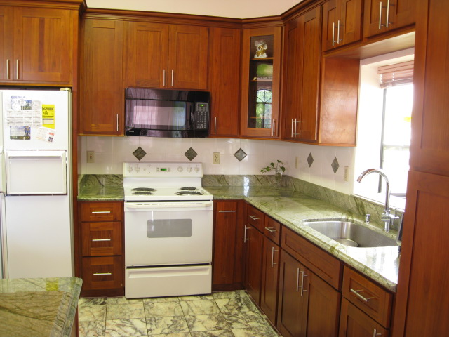 Golden Cabinets Stone Inc