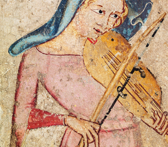 A vielle, an ancestor of the modern violin, appears in a 1330 fresco. Museum of Navarra, Pamplona.  PHOTOGRAPH BY BRIDGEMAN/ACI