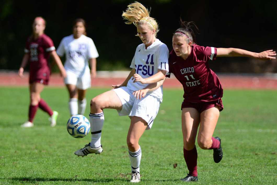SF State's Julie Haselton (11) fights off Gail Bassett (11) for control of the ball during a game against Chico State at Cox Stadium, Oct. 6, 2013. The Gators won the game 1-0. Photo by Philip Houston / Xpress