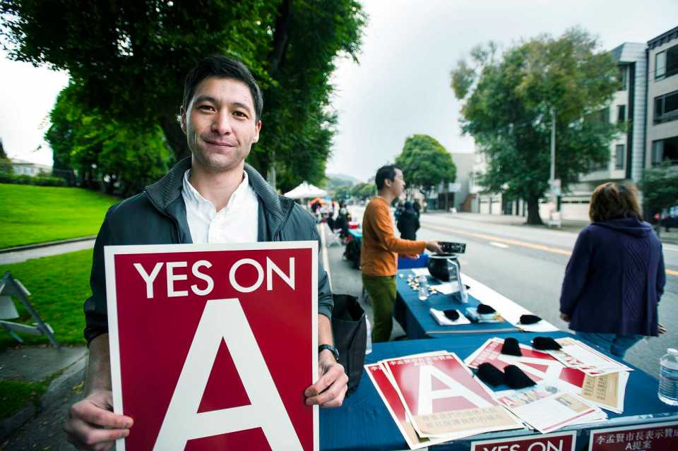Nicholas Lucas campaigns for prop A protecting San Francisco retirees during a Sunday Street event on Arguello boulevard on Sunday, Oct. 27, 2013. Photo by Benjamin Kamps / Xpress