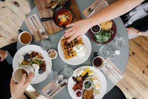Image of customers eating breakfast at a restaurant