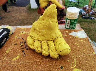 Feet modelled in yellow plasticine from life model at Art in Action Festival 2014