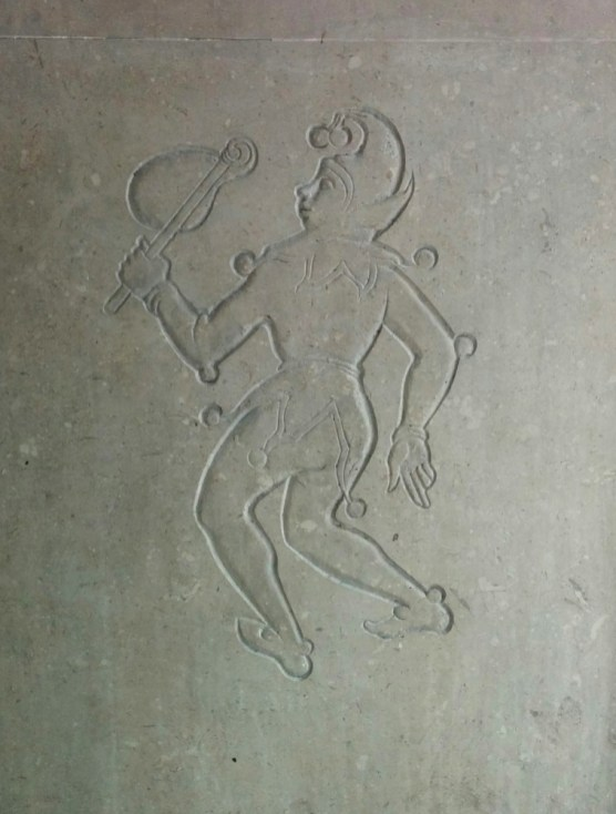 Jester type figure with bladder on a stick