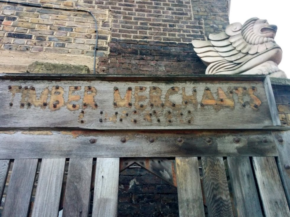 The entrance of Granite & Marble UK Ltd with ghost signage from its previous life as a timber yard