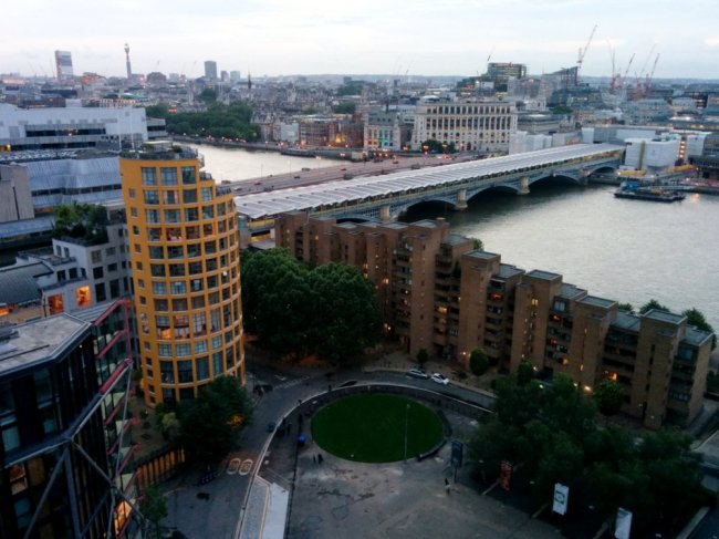 Looking down from Switch House viewing level over Blackfriar's Station crossing the Thames