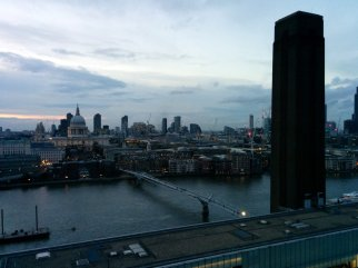 Looking down from Switch House viewing level looking over the Thames with the 'wobbly bridge' crossing the Thames, and the Tate's Boiler House chimney to the right