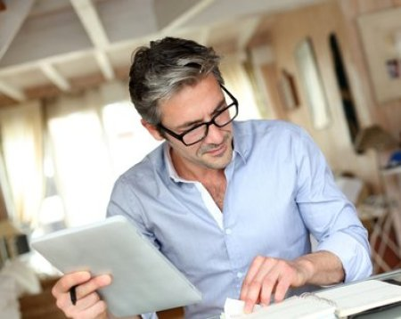 Businessman with eyeglasses working from home telecommuters