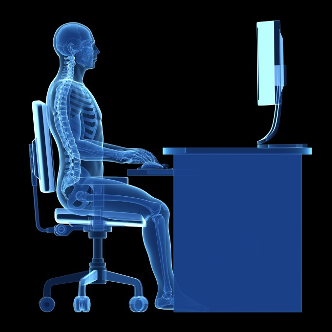 x-ray of employee at desk