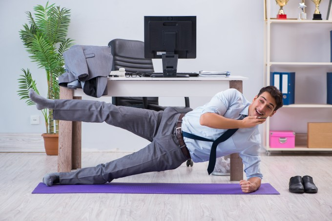 employee stretching while on business call
