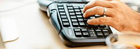 man at egonomic keyboard