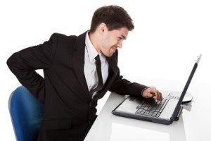 Businessman with lower back ache office ergonomics