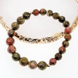 Faceted unakite with two mini gold plated beads