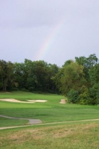 GolfTheUnitedStates com  Woodmore CC    The Country Club at Woodmore     A rainbow presides over the dogleg on the 7th hole