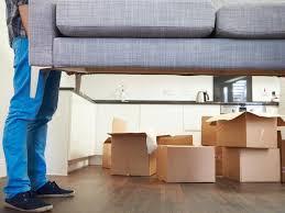 man lifting sofa