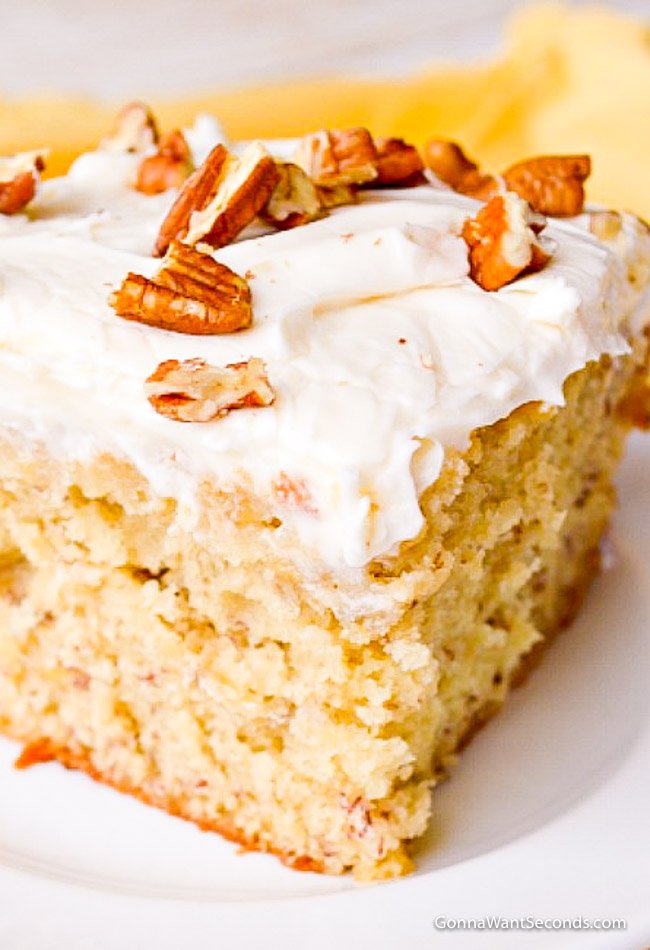 Banana Cake with Cream Cheese Frosting   Gonna Want Seconds A slice of Banana Cake with Cream Cheese Frosting topped with pecans
