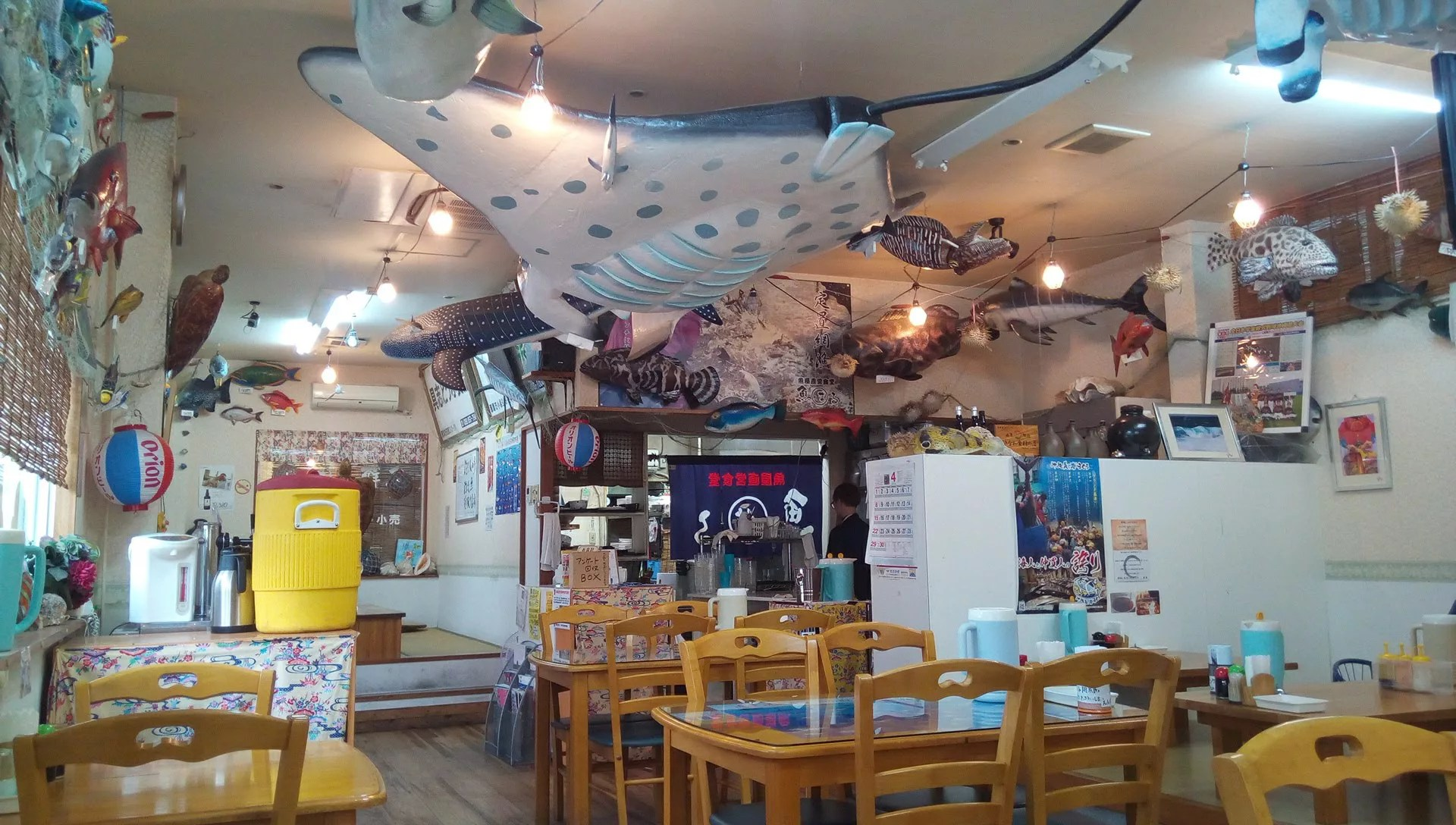 The inside of the shop is decorated with a lot of fish models