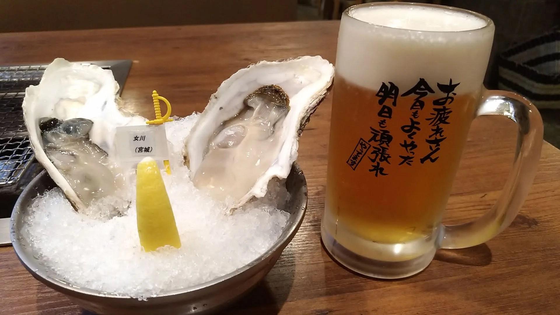 生ビールとお通しの生牡蠣