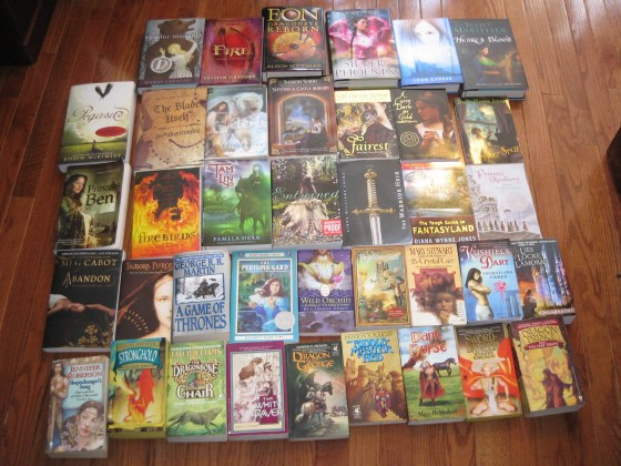 pool of reads, fantasy books pile,
