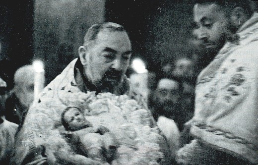 Padre Pio holding the Divine Infant