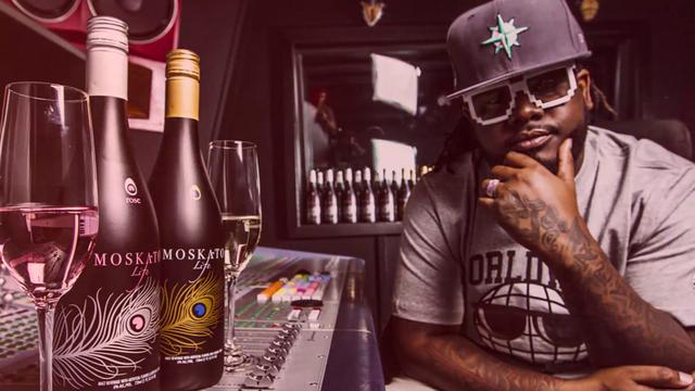 Questionably talented rapper T-pain promoting the bile-inducing beverage that is Moskcato Life.