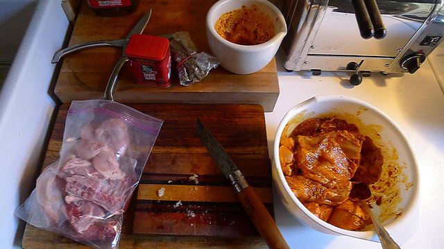 Antibiotic and Hormone Free, Naturally Raised, Free Range Ontario Chicken from Little Portugal's Nosso Talho... plenty of meat for my Morrocan Casserole and back, wings, and neck for stock... and all for $11.54
