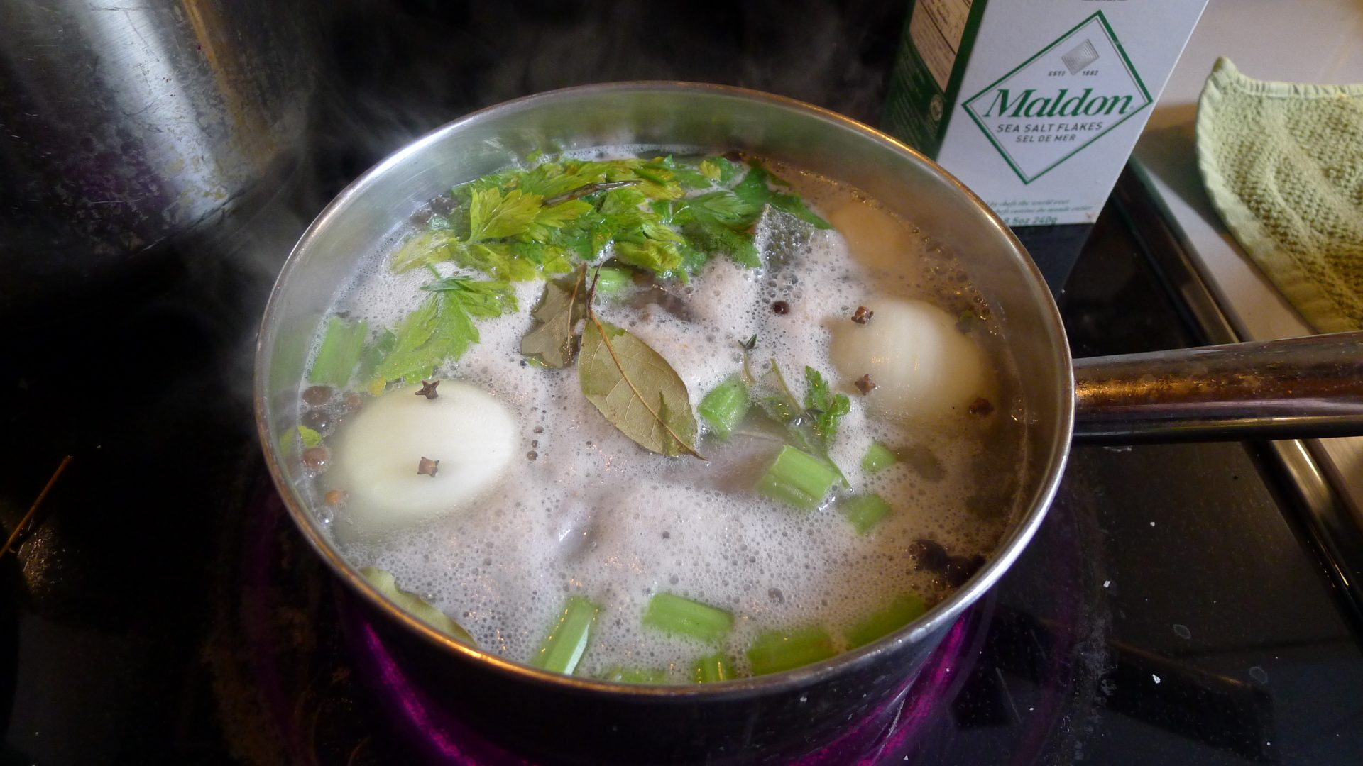 Bring to the boil, being sure to remove any of the admittedly nasty scum that rises to the surface. THIS IS IMPORTANT. Turn down to a gentle, just-moving simmer and leave for around two hours (uncovered).