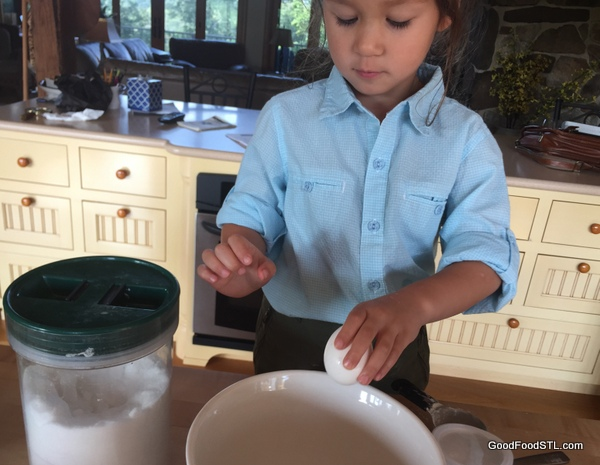 Breaking the egg into the batter