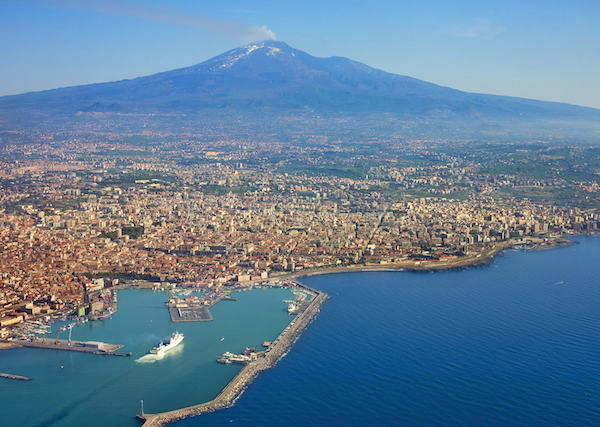 Air photo of Catania city in Sicily with Mount Etna