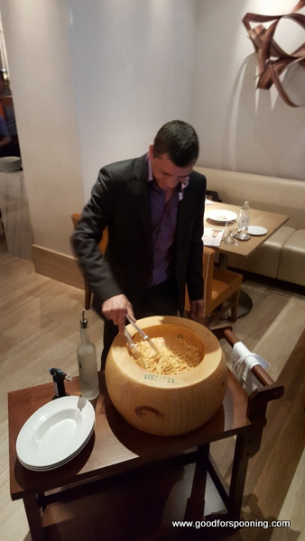 Enrico prepares the fettuccini in the hollowed out Parmigiano Reggiano wheel.