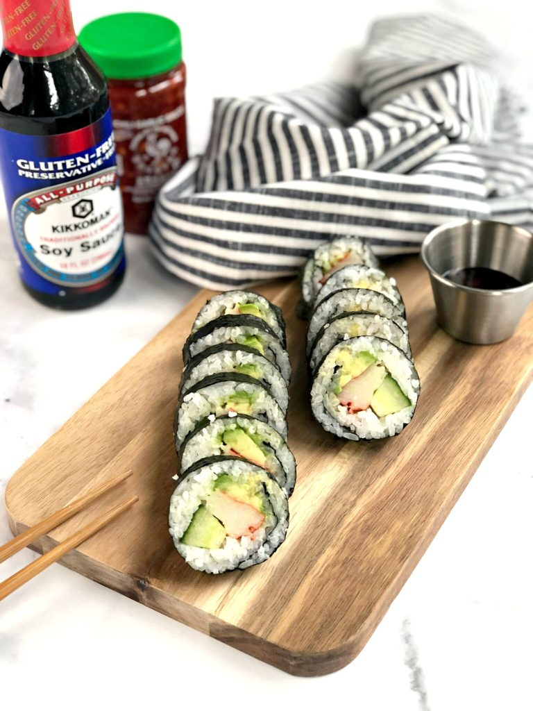 Cut sushi rolls with soy sauce and chili garlic sauce