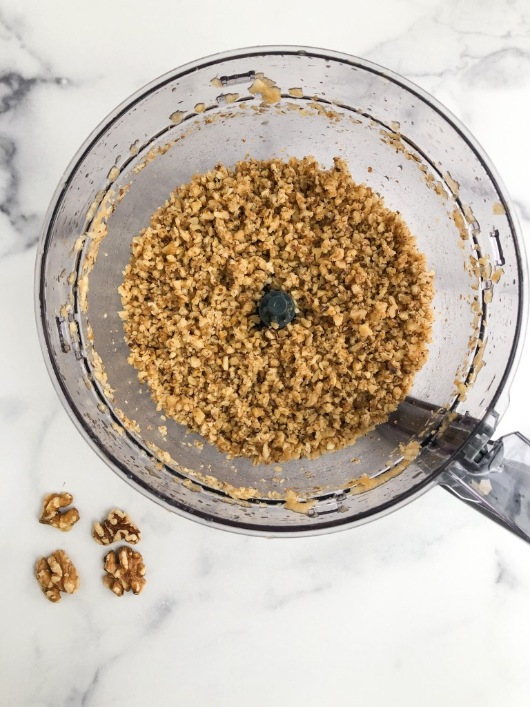 chopped walnuts in food processor
