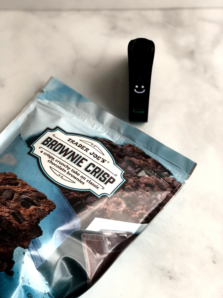 The Nima Sensor is smiling after testing the Trader Joe's Brownie bites for gluten