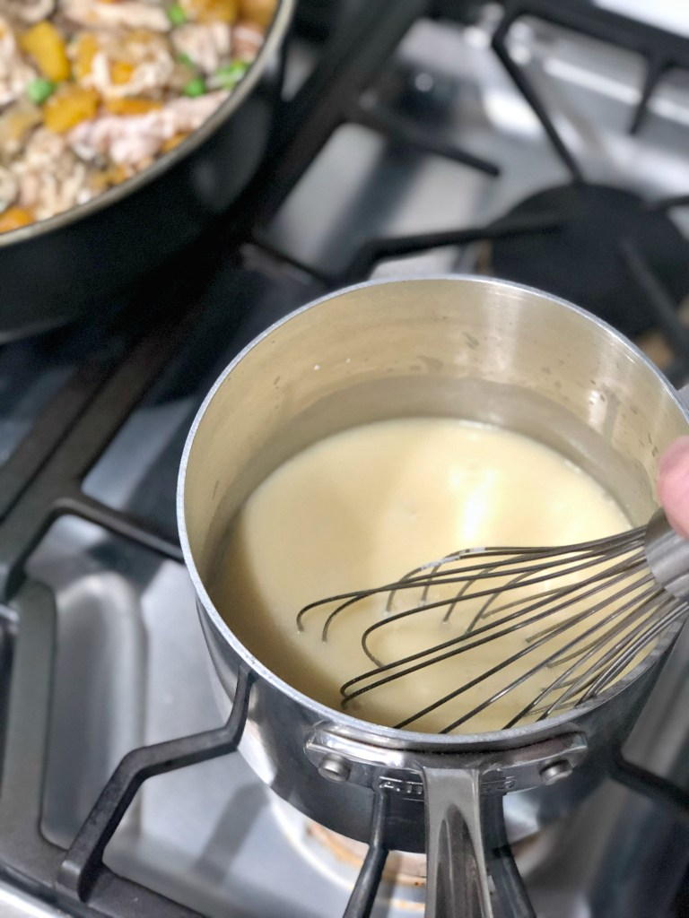 Butter and flour mixed to make creamy sauce for gluten-free chicken pot pie