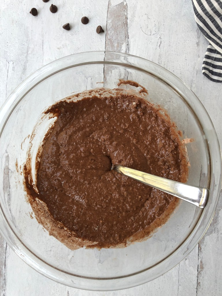 Chocolate pudding cake batter mixed together in a bowl