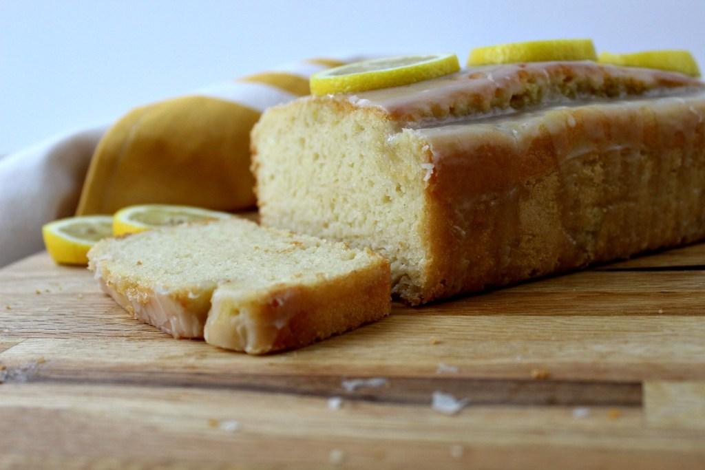 Horizontal close up on lemon pound cake with slice