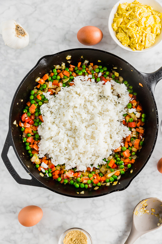 white rice atop cooked vegetables