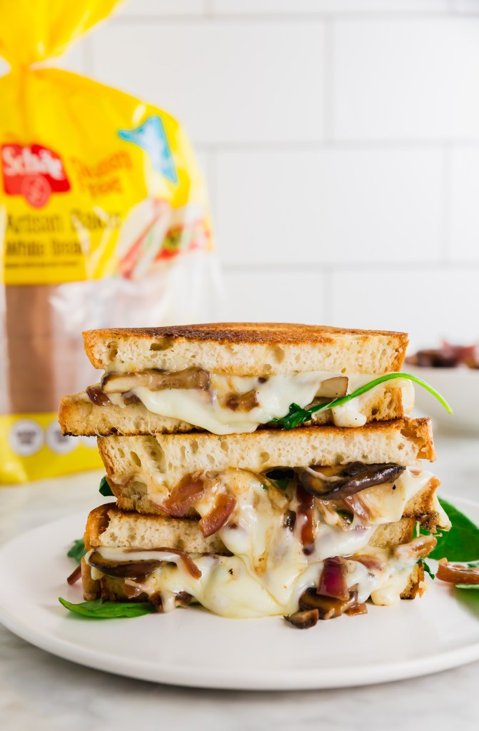 gluten-free grilled cheese sandwich with oozing cheese and Schar bread packaging in background